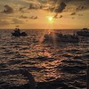 The now: sunset as the boats all gather for a night time dive with manta rays.