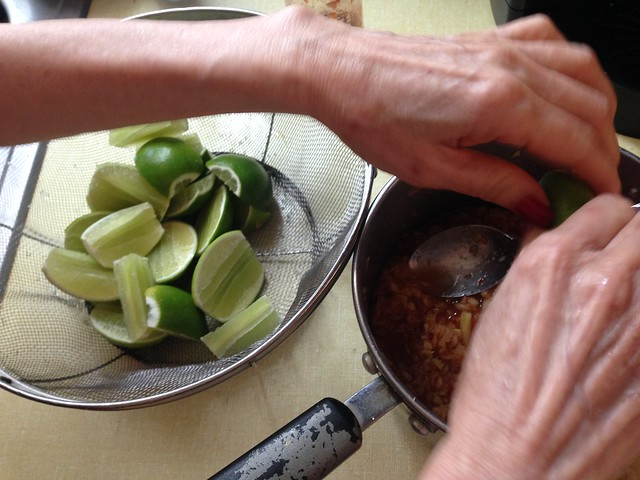Squeezing lime wedges in to the sauce pan