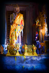 Buddha statue with Golden Robes and Offerings