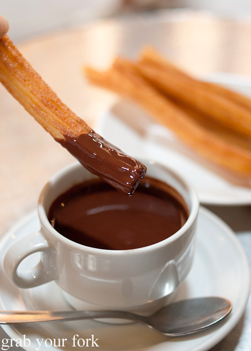 Hot sugar-coated churros dipped into thick Spanish hot chocolate at Chocolateria San Gines in Madrid, Spain