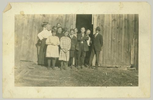Group at barn door