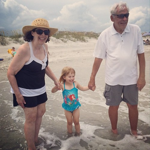 Favorite pic from today: Lucy in the ocean with my parents. This is the first time she hasn't been scared of the beach.