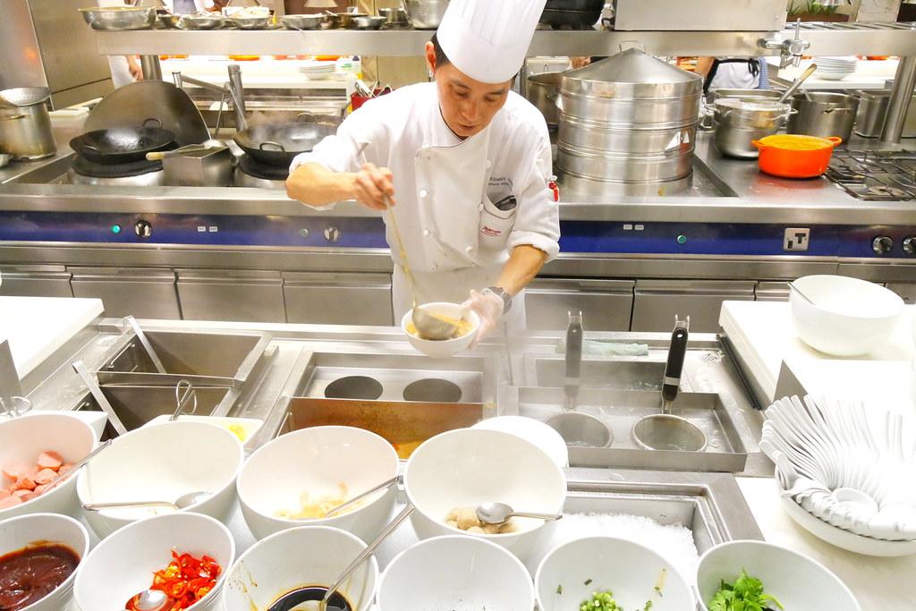 Marriott Cafe. Chef Preparing Food.