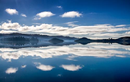 ocean blue newzealand sky espelho azul clouds reflections landscape mirror islands mar seascapes silhouettes paisaje paisagem céu hills cielo nubes espejo nuvens reflexos islas siluetas reflejos oceano novazelândia atmosphericperspective ilhas nuevazelanda colinas silhuetas paisajemarítimo perspectivaatmosférica paisagemmarítima