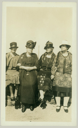 Four women in hats