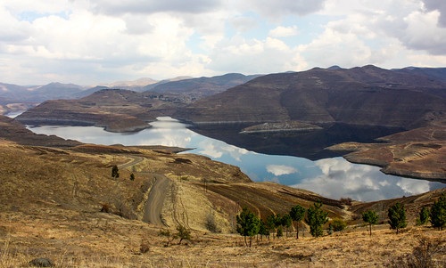 africa lesotho mountains drakensberg lake reservoir water car road roadtrip adventure explore wilderness wild culture people places land landscape beauty nature natural canon village