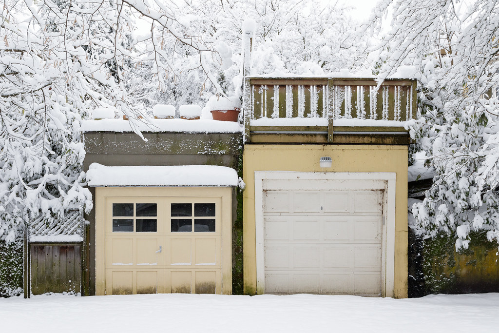 Snow covered yellow garages on a winter morning