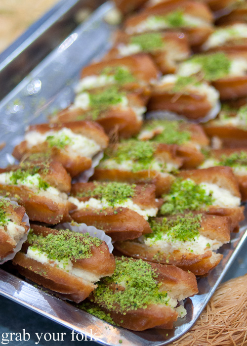 Sweet Lebanese pastries with ashta clotted cream and pistachios on a Frying Pan Adventures food tour in Dubai