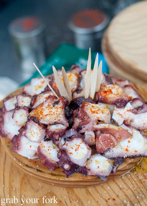 Plate of Pulpo a Gallega Galician octopus at Mercado de Abastos farmers market in Santiago de Compostela, Spain