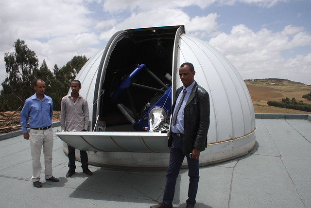 Solomon Belay, director of the Entoto Observatory and Research Centre, stands on the right-hand side of one of the observatory's two telescopes situated in the Entoto Mountains, overlooking the Ethiopian capital, Addis Ababa. Credit: James Jeffrey/IPS