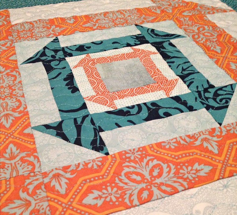 Nested Churn Dash quilting detail