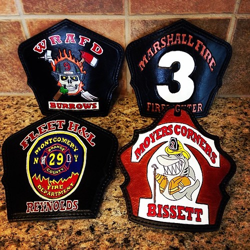 Four fire helmet shields