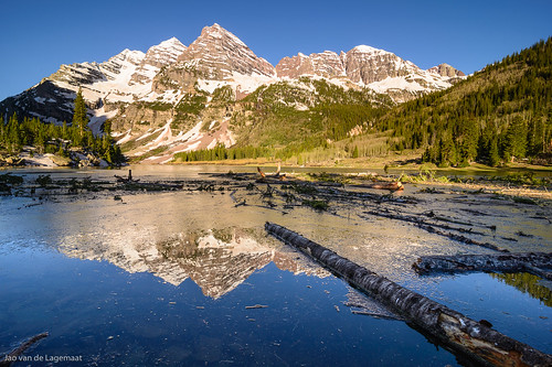 usa sun mountain lake snow mountains reflection water sunrise landscape colorado unitedstates northamerica craterlake aspen maroonbellssnowmasswilderness