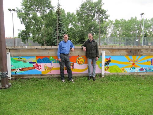 <p>SCCL board member Mark Anielski and artist Carveor Triggs.</p>