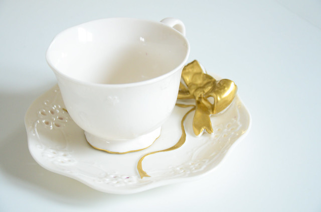 Gold Paint sharpie DIY on a tea cup and pretty gold bow