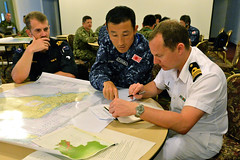 Planners work together on the HA/DR scenario for RIMPAC. (U.S. Navy/MC2 Taylor Smith)