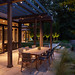 Outdoor dining area at dusk. Lighting by Outdoor Illumination Inc. Photo credit: David Burroughs