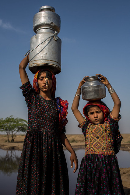 Dhaneta Jat tribe girls carrying water containers on the head in great rann of kutch