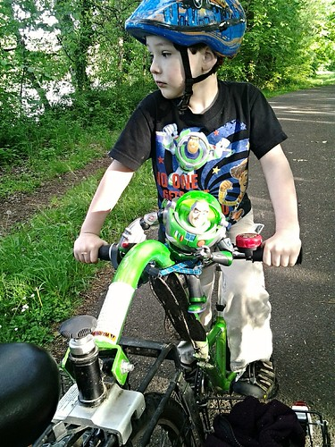 Boy and Buzz On a Bicycle 1