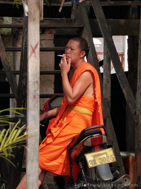 Luang Prabang Wat Manorom 01 Smoking Monk