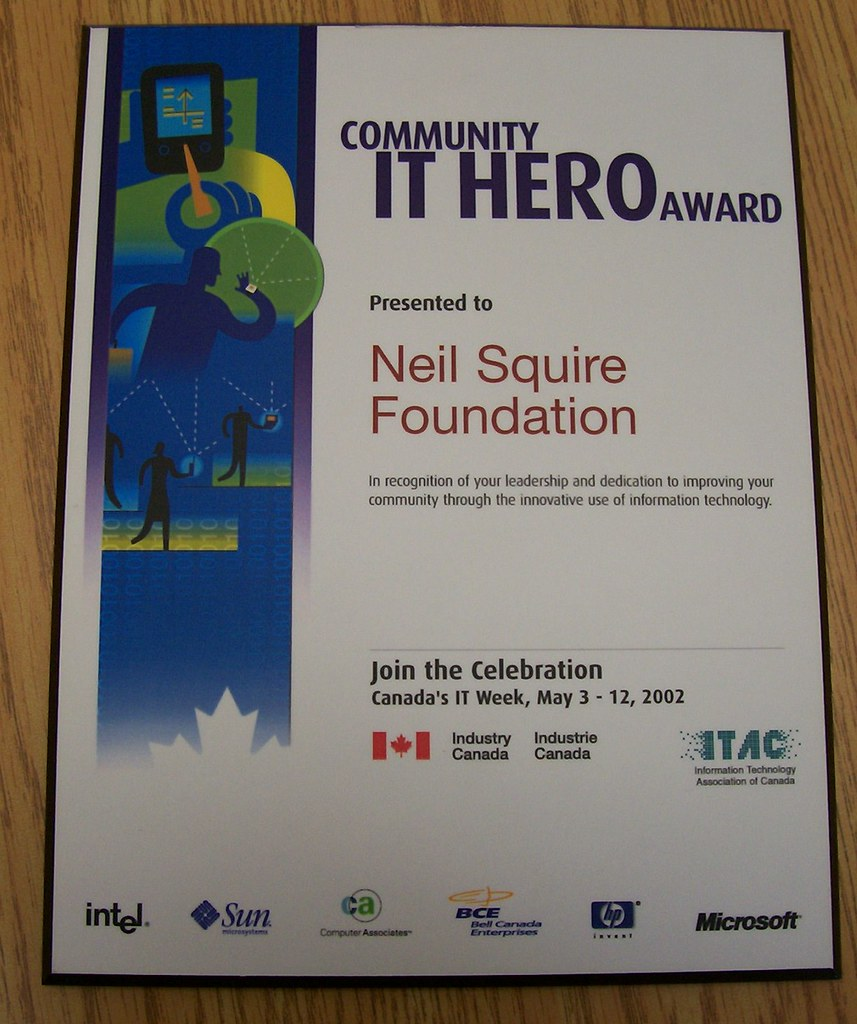 Photograph of the Community Information Technology Hero award presented to the Neil Squire Foundation in 2002.