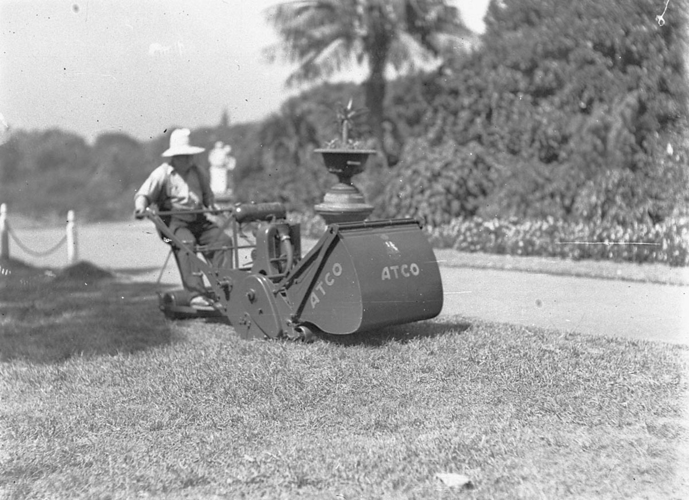 Gardener on Atco ride-on lawn mower, c. 1932, by Ted Hood