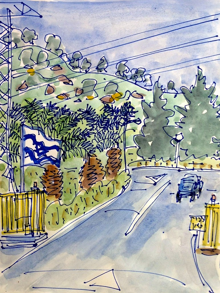 entrance to the moshav with flag