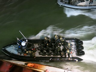 NEW YORK – The Maritime Security Response Team's tactical boat delivery team (TDT) prepares to deploy members by maneuvering alongside a Staten Island Ferry during an exercise in New York Harbor, March 19, 2014. The TDT specialize in multiple-boat tactics for the undetected, offshore delivery of an MSRT boarding team. The team was part of a large-scale exercise involving federal, state and local port partners, to guard against maritime terrorism threats.  U.S. Coast Guard photo by Petty Officer 2nd Class Jetta H. Disco.