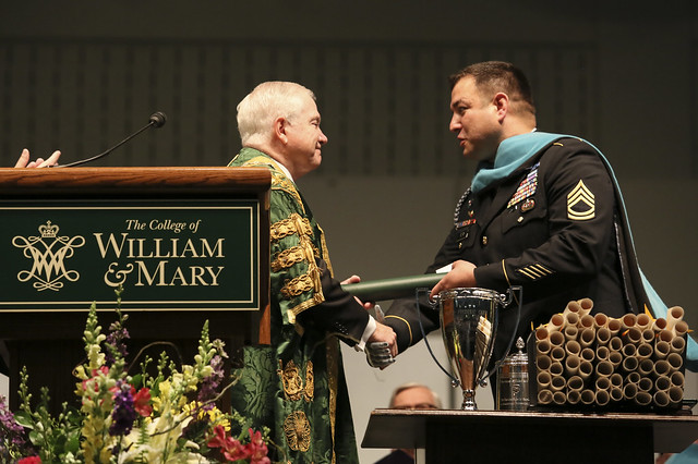 Sgt. 1st Class Leroy A. Petry receives his honorary degree from Chancellor Robert M. Gates '65