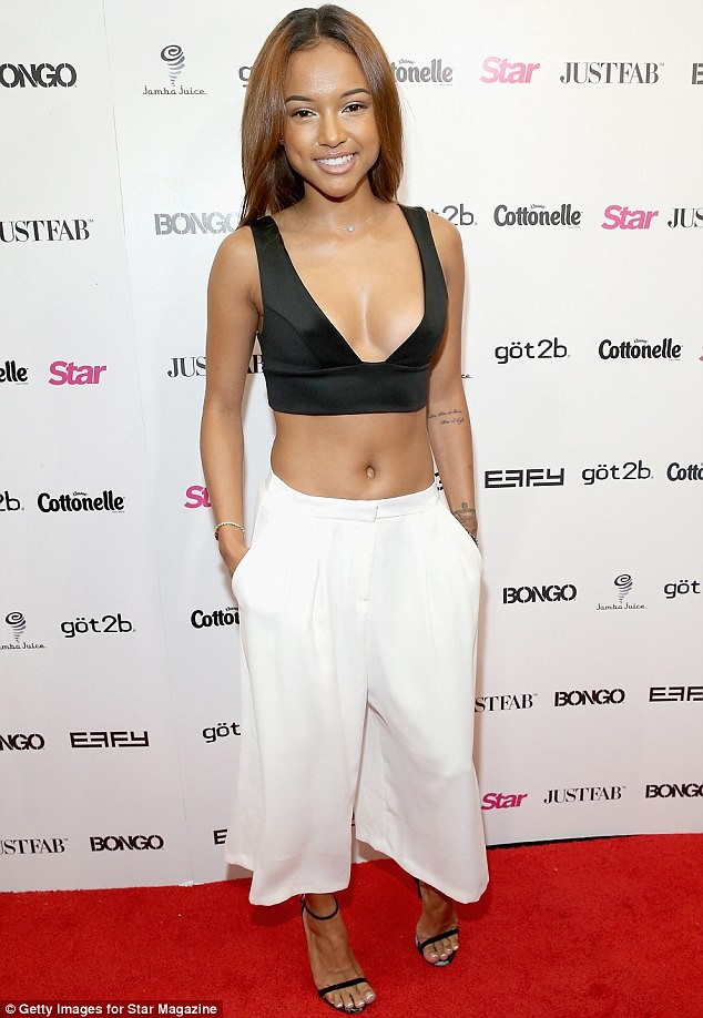 Culottes-Spring-summer-trend, plunging neckline, plunging neckline top, plunging neckline bralet, bralet, low cut bralet, V-neck bralet, plunging neckline bralet, risqué top, loose white trousers, open-toed sandals, culottes,  strapped black heels, flaring white trousers, black crop top and culottes, how to style culottes, how to wear culottes, culottes trend