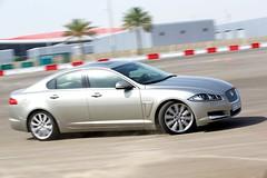 bmw(0.0), bmw 6 series(0.0), bmw 5 series(0.0), sports car(0.0), automobile(1.0), automotive exterior(1.0), executive car(1.0), wheel(1.0), vehicle(1.0), performance car(1.0), automotive design(1.0), sports sedan(1.0), rim(1.0), full-size car(1.0), bumper(1.0), jaguar xf(1.0), sedan(1.0), personal luxury car(1.0), land vehicle(1.0), luxury vehicle(1.0),
