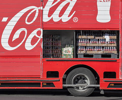 double-decker bus(0.0), vehicle(1.0), truck(1.0), soft drink(1.0), red(1.0), carbonated soft drinks(1.0), drink(1.0), cola(1.0), coca-cola(1.0),