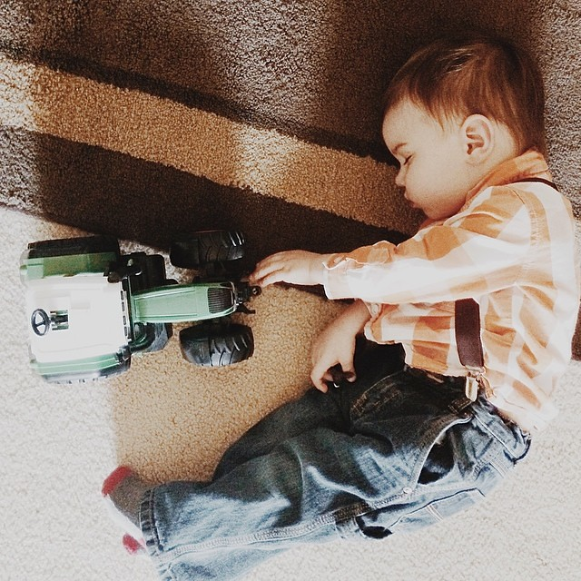 Refused to sleep during nap/quiet time. Fell asleep playing with his beloved tractor. #instaluther #toddler #tractor #sleepingchildren