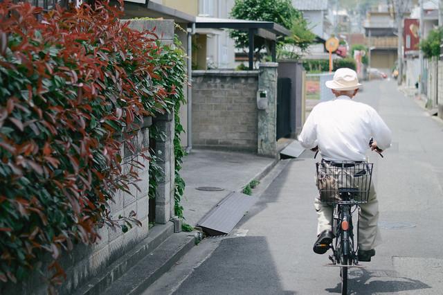 man riding bicycle japan