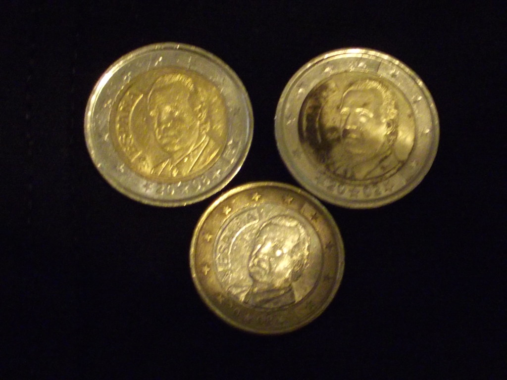 Juan Carlos I - reverse of a 1 Euro coin and 2x 2 Euro coins