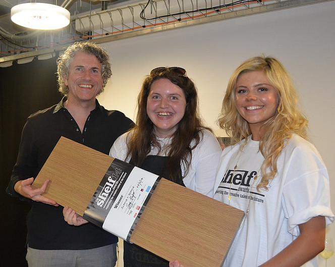 The Shelf Awards 2014 winners, Sophia Johnson and Sophie Szilady, receive that all important pice of wood from founder Gary Sharpen