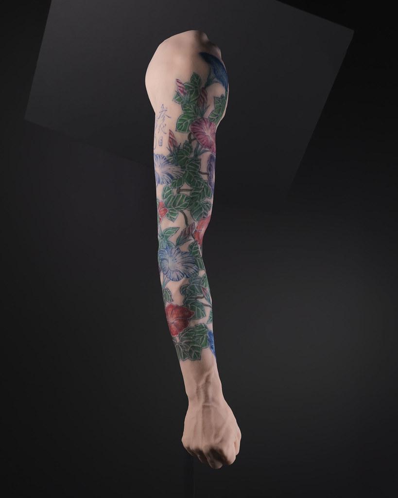 Motif de tatouage sur un bras masculin