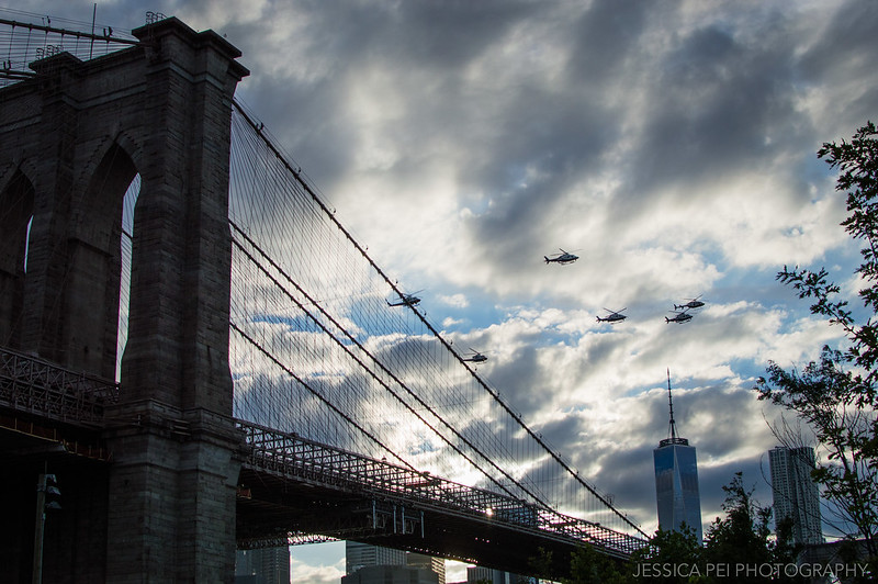 Helicopters over Brooklyn Bridge New York
