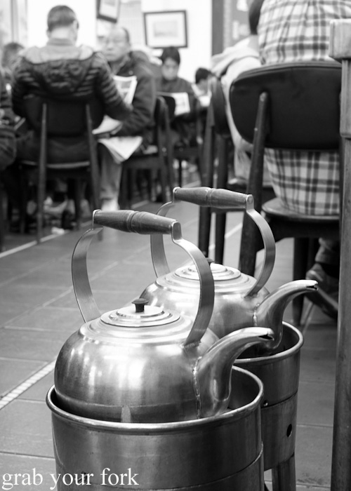 Giant kettles of boiling water for refilling tea pots at Lin Heung Tea House in Hong Kong