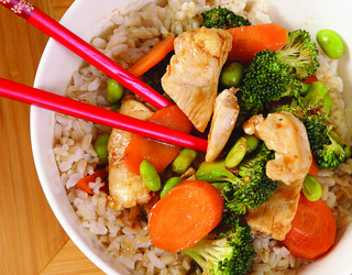 Picture of a bowl of stir fry with rice.