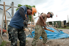 U.S. Navy Steelworker 2nd Class Felipe Esparza, right, and a Philippine Navy counterpart work together on an outpatient maternity ward project in Tacloban. (U.S. Navy/MCC Greg Badger)