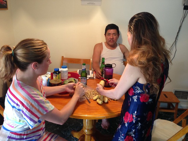 Peeling ginger with mom while dad looks on