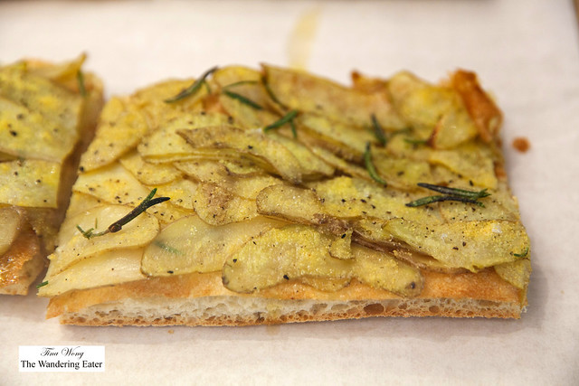 Pizza bianca - flatbread topped with potatoes and rosemary