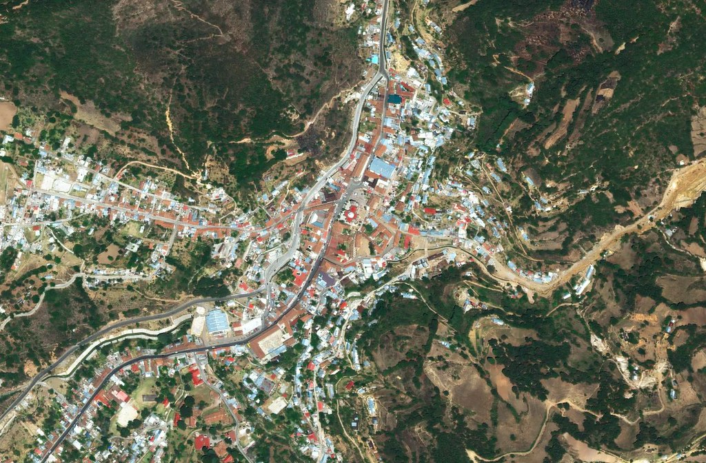 A colorful mining town set between steep hills