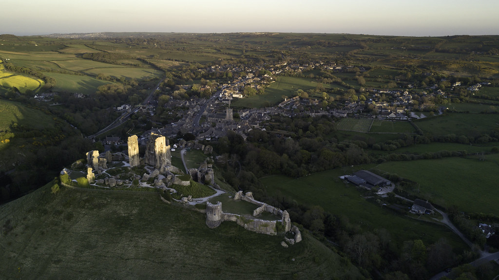 Sun setting over Corfe Castle looking over the village - Click to show full size