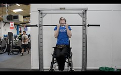Surrey fitness instructor Anton Brown does wheelchair chin-up