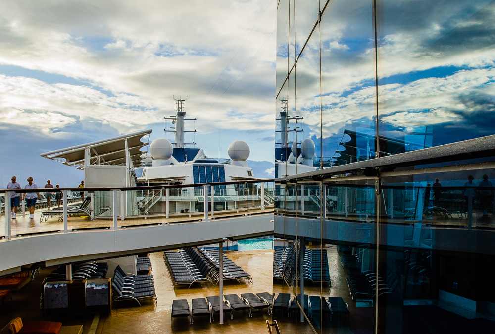 Morning clouds reflecting on Celebrity Silhouette's glass panels