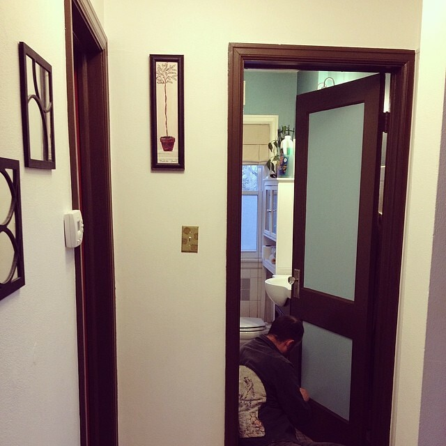 We finally made time to paint our downstairs hallway. I can't believe how much better it looks. Also, my husband is the trim whisperer. Seriously, he never ever uses tape and the lines come out perfect every time.