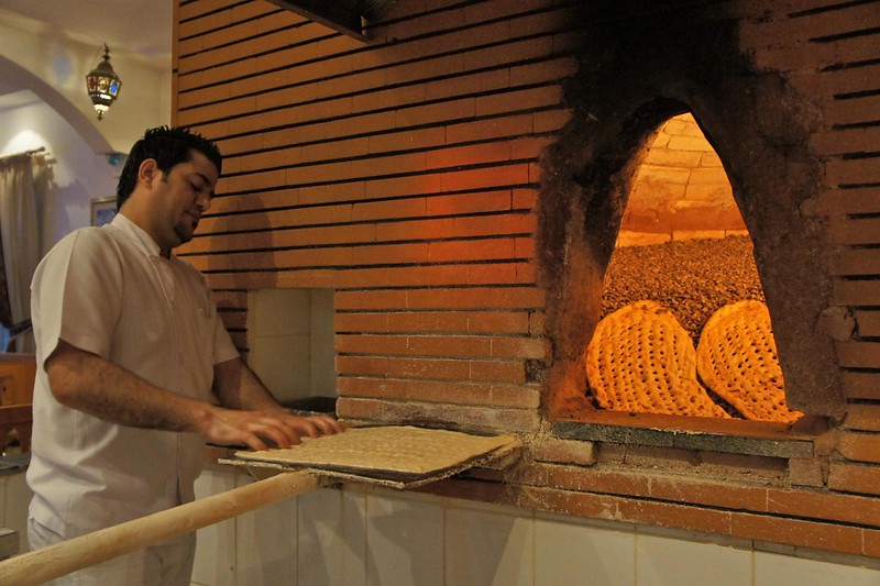 Iranian-style bread cooked on hot pebbles at Abshar Restaurant, Diera