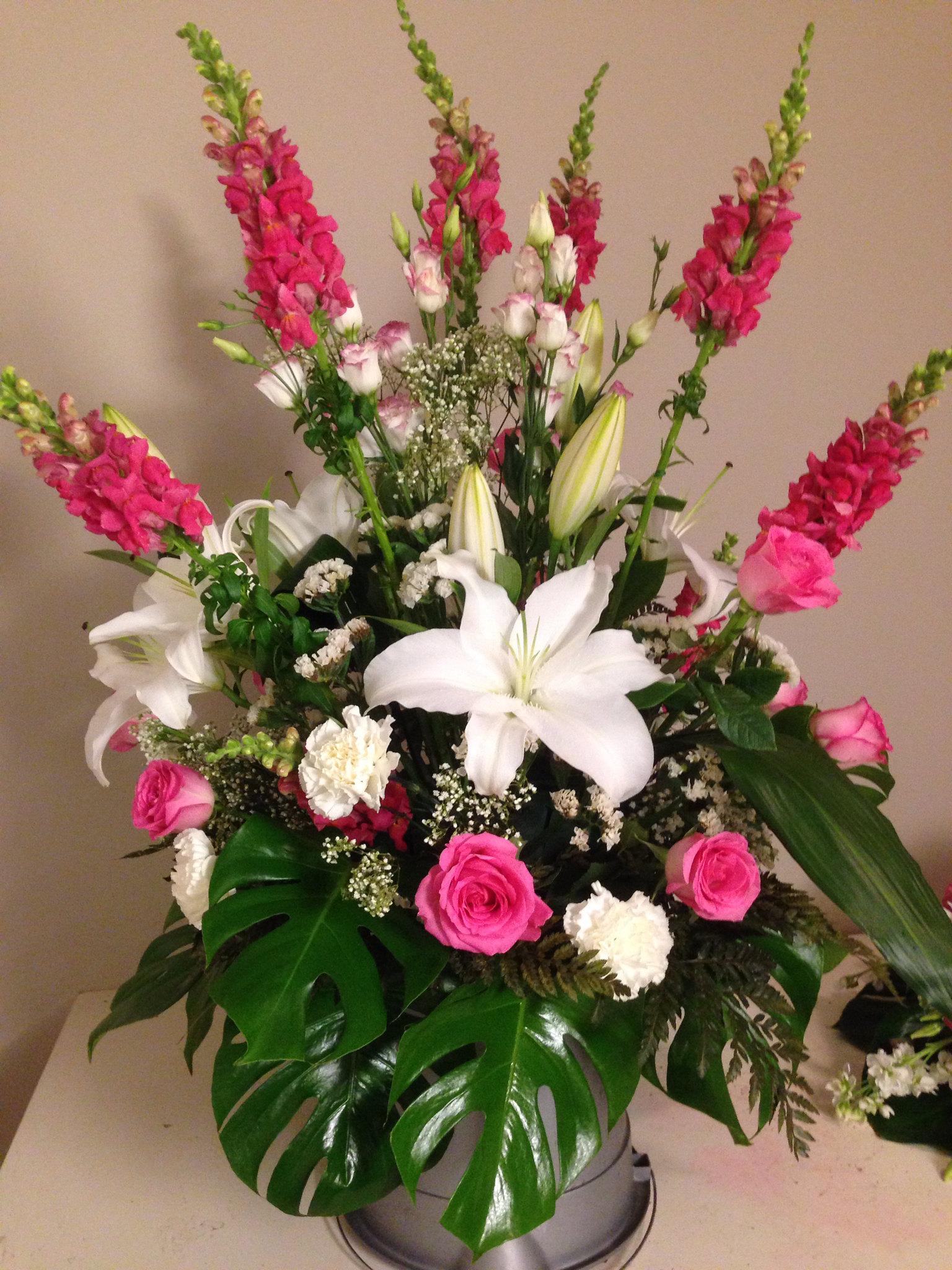 Farah florist C-P16.     $85-100 arrangement